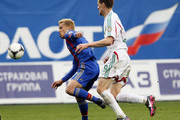 Keisuke Honda (L) of PFC CSKA Moscow in action against Oleg Ivanov of FC Terek Grozny during the Russian Premier League match between PFC CSKA Moscow and FC Terek Grozny at the Arena Khimki Stadium on May 04, 2013 in Khimki, Russia.