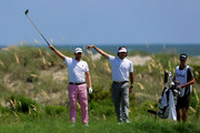Webb Simpson (L) and Bubba Watson of the United States gesture after Simpson hits off the sixth tee during Round One of the 94th PGA Championship at the Ocean Course on August 9, 2012 in Kiawah Island, South Carolina.