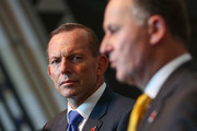 New Zealand Prime Minister John Key speaks while Australian Prime Minister Tony Abbott looks on during a press conference at Te Papa Museum on April 20, 2015 in Wellington, New Zealand. Australian Prime Minister Tony Abbott is in Wellington today as part of commemorations ahead of the 100th anniversary of the ANZAC landings at Gallipoli.