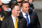 New Zealand Prime Minister John Key (L) and Australian Prime Minister Tony Abbott arrive during the opening of the Australian Memorial at Pukeahu National War Memorial Park on April 20, 2015 in Wellington, New Zealand. Australian Prime Minister Tony Abbott is in Wellington today as part of commemorations ahead of the 100th anniversary of the ANZAC landings at Gallipoli.