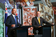 Australian Prime Minister Tony Abbott speaks while New Zealand Prime Minister John Key looks on during a press conference at Te Papa Museum on April 20, 2015 in Wellington, New Zealand. Australian Prime Minister Tony Abbott is in Wellington today as part of commemorations ahead of the 100th anniversary of the ANZAC landings at Gallipoli.