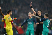 Hugo Lloris of Tottenham Hotspur is shown a red card by referee Slavko Vincic during the Group B match of the UEFA Champions League between PSV and Tottenham Hotspur at Philips Stadion on October 24, 2018 in Eindhoven, Netherlands.