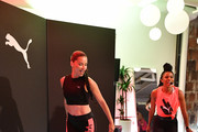 PUMA Global Ambassador Adriana Lima (L) and Deja Riley lead a high-intensity workout class as PUMA And Refinery29 Host The Launch Of The New PUMA LQD CELL Shatter Shoe at Refinery29 on July 11, 2019 in New York City.