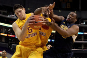 Nikola Vucevic #5 and Alex Stepheson #1 of the USC Trojans battle for a rebound with Markhuri Sanders-Frison #10 of the California Golden Bears in the second half in the quarterfinals of the 2011 Pacific Life Pac-10 Men's Basketball Tournament at Staples Center on March 10, 2011 in Los Angeles, California.