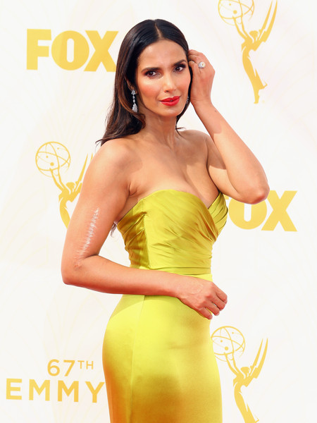 67th Annual Primetime Emmy Awards - Arrivals [clothing,yellow,fashion model,dress,cocktail dress,strapless dress,photo shoot,hairstyle,long hair,waist,arrivals,padma lakshmi,tv personality,microsoft theater,los angeles,california,primetime emmy awards]