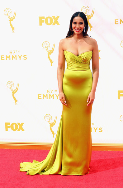 67th Annual Primetime Emmy Awards - Arrivals [dress,clothing,fashion model,yellow,gown,carpet,red carpet,strapless dress,flooring,shoulder,arrivals,padma lakshmi,tv personality,microsoft theater,los angeles,california,primetime emmy awards]