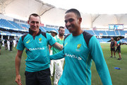 Usman Khawaja and Marnus Labuschagne of Australia  celebrate after Australia held on to draw the test match during day five of the First Test match in the series between Australia and Pakistan at Dubai International Stadium on October 11, 2018 in Dubai, United Arab Emirates.