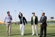 Sarfraz Ahmed of Pakistan and Tim Paine of Australia toss the coin during day one of the Second Test match between Australia and Pakistan at Sheikh Zayed stadium on October 16, 2018 in Abu Dhabi, United Arab Emirates.