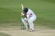 Sarfraz Ahmed of Pakistan is struck on the helmet by a short delivery during day three of the Second Test match between Australia and Pakistan at Sheikh Zayed stadium on October 18, 2018 in Abu Dhabi, United Arab Emirates.