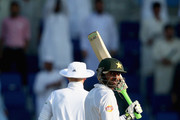 Shoaib Malik of Pakistan celebrates after reaching his century during Day One of the First Test between Pakistan and England at Zayed Cricket Stadium on October 13, 2015 in Abu Dhabi, United Arab Emirates.