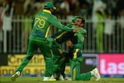 Shoaib Malik of Pakistan celebrates with teammates after bwoling England captain Eoin Morgan during the 3rd One Day International match between Pakistan and England at Sharjah Cricket Stadium on November 17, 2015 in Sharjah, United Arab Emirates.