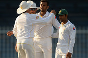 Shoaib Malik of Pakistan celebrates with teammates after dismissing Moeen Ali of England during day four of the 3rd Test between Pakistan and England at Sharjah Cricket Stadium on November 4, 2015 in Sharjah, United Arab Emirates.