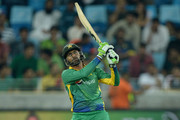 Shoaib Malik of Pakistan hits out for six runs during the 4th One Day International between Pakistan and England at Dubai Cricket Stadium on November 20, 2015 in Dubai, United Arab Emirates.