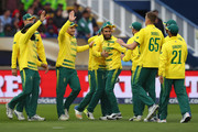 Imran Tahir (C) of South Africa celebrates taking a catch off the bowling of Morne Morkel to dismiss Mohammad Hafeez of Pakistan during the ICC Champions Trophy match between Pakistan and South Africa at Edgbaston on June 7, 2017 in Birmingham, England.