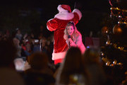 Santa Claus and Sarah Michelle Gellar perform at the annual Christmas tree lighting ceremony at Palisades Village on November 24, 2019 in Pacific Palisades, California.
