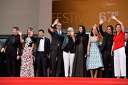 (L-R) Jury members Willem Dafoe, Sofia Coppola, Zhangke Jia, Nicolas Winding Refn, Jane Campion, Leila Hatami, Do-yeon Jeon, Gael Garcia Bernal and Carole Bouquet attend the red carpet for the Palme D'Or winners at the 67th Annual Cannes Film Festival on May 25, 2014 in Cannes, France.