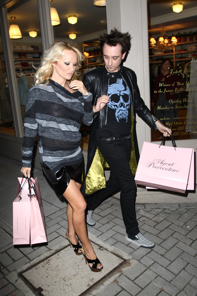 Pamela Anderson steps out with 'Alan' the latest star of the Doritos TV advert on October 27, 2009 in London, England.
