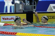 Katie Ledecky (L) of the United States reacts after winning the gold medal in the Women's 400m Freestyle on day three of the Pan Pacific Swimming Championships at Tokyo Tatsumi International Swimming Center on August 11, 2018 in Tokyo, Japan.