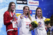(L to R) Silver medalist Taylor Ruck of Canada, gold medalist Kathleen Baker of the United States and bronze medalist Regan Smith of the United States celebrate on the podium at the medal ceremony for the Women's 200m Backstroke on day four of the Pan Pacific Swimming Championships at Tokyo Tatsumi International Swimming Center on August 12, 2018 in Tokyo, Japan.