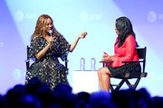 Tyra Banks (L) and Michelle Ebanks speak onstage during the 'Tyra Banks' Trail Blazing Entertainment Ventures - What's Next?: A Phygital Dream Come True' panel at AT&T SHAPE at Warner Bros. Studios on June 22, 2019 in Burbank, California.
