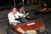 """Singer Jared Followill (R) and guest attends the Neon Carnival with PacSun, """"Dope the Movie and Tequila Don Julio at the Thermal Hangar on April 11, 2015 in Thermal, California."""