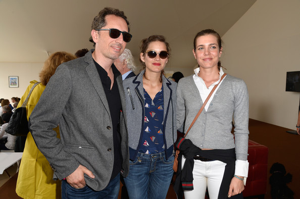 (L-R) Gad Elmaleh, Marion Cotillard and Charlotte Casiraghi attend the Paris Eiffel Jumping presented by Gucci at Champ-de-Mars on July 5, 2014 in Paris, France.