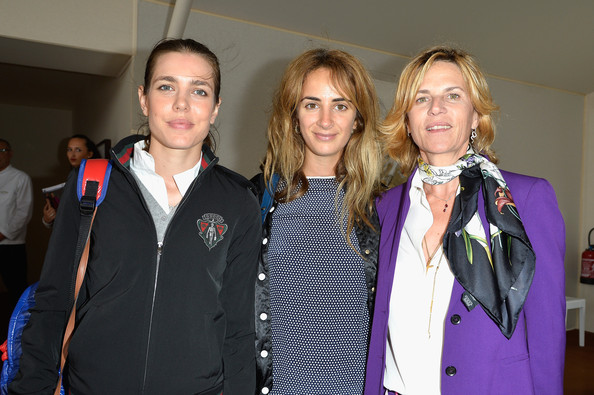 (L-R) Charlotte Casiraghi, Alexia Niedzielski and Virginie Couperie-Eiffel attend the Paris Eiffel Jumping presented by Gucci at Champ-de-Mars on July 5, 2014 in Paris, France.