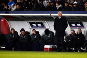 PSG Manager, Carlo Ancelotti stands on the side lines as David Beckham of PSG is pictured on the bench with his new team mates prior to the Ligue 1 match between Paris Saint-Germain FC and Olympique de Marseille at Parc des Princes on February 24, 2013 in Paris, France.