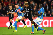 Neymar of Paris Saint-Germain is challenged by Mario Rui and Kalidou Koulibaly of Napoli during the Group C match of the UEFA Champions League between Paris Saint-Germain and SSC Napoli at Parc des Princes on October 24, 2018 in Paris, France.