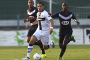 Djamel Mesbah of Parma FC competes for the ball with Diego Rolan Silva of FC Girondins de Bordeaux during a pre-season tournament match between Parma FC, US Avellino and FC Girondins de Bordeaux at Stadio Partenio on August 2, 2014 in Avellino, Italy.