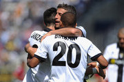Davide Lanzafame (L) of Parma FC celebrates his goal with Hernan Crespo (C) and Jonathan Ludovic Biabiany during the Serie A match between Parma FC and AS Livorno Calcio at Stadio Ennio Tardini on May 16, 2010 in Parma, Italy.