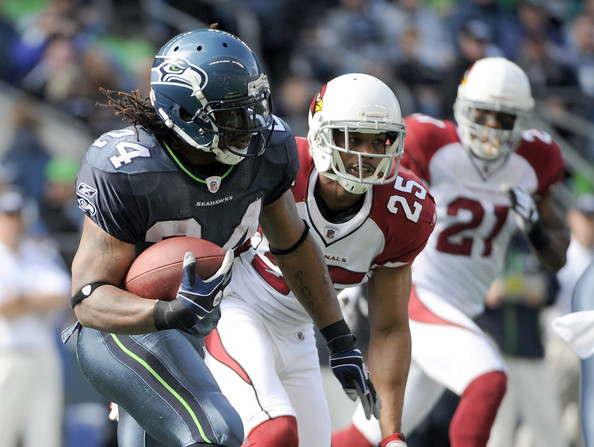 Patrick Peterson Marshawn Lynch #24 of the Seattle Seahawks runs after a handoff in front of  Kerry Rhoades #25 nd  Patrick Peterson #21 of the Arizona Cardinals during the first quarter at CenturyLink Field on September 25, 2011 in Seattle, Washington.