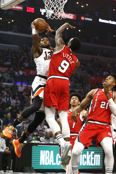 Portland Trail Blazers vs Los Angeles Clippers [photograph,player,basketball moves,sports,tournament,basketball player,team sport,ball game,basketball,product,fan,paul george,user,user,note,ball,los angeles,los angeles clippers,portland trail blazers,half]
