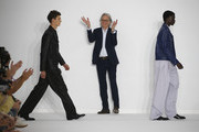 British designer Sir Paul Smith acknowledges the audience at the end of the Paul Smith Menswear Spring Summer 2020 show as part of Paris Fashion Week on June 23, 2019 in Paris, France.