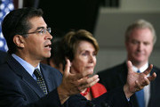 (L-R) Democratic Caucus Vice Chairman Rep. Xavier Becerra (D-CA) speaks as House Minority Leader Rep. Nancy Pelosi (D-CA) and Ranking Member of the House Budget Comittee Rep. Chris Van Hollen (D-MD) listen during a news conference on October 2, 2012 in Washington, DC. House Democrats called on House Republicans to cancel their recess and return to Washington to work for middle class Americans.