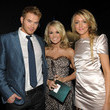 She poses for the camera with Kellan Lutz and Katie Cassidy.