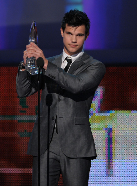 Actor Taylor Lautner accepts the award for Favorite Breakout Movie Actor onstage during the People's Choice Awards 2010 held at Nokia Theatre L.A. Live on January 6, 2010 in Los Angeles, California.