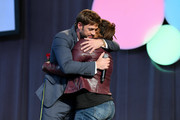 William Levy hugs superfan Luz Subervi on stage during People en Español 6th Annual Festival to Celebrate Hispanic Heritage Month - Day 2 on October 06, 2019 in New York City.