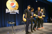 (L-R) Musicians Jonny Buckland, Guy Berryman, Chris Martin and Will Champion of Coldplay onstage at the Pepsi Super Bowl Halftime Press Conference on February 4, 2016 in San Francisco, California.