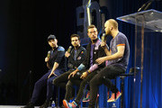(L-R) Musicians Jonny Buckland, Guy Berryman, Chris Martin and Will Champion of Coldplay speak onstage at the Pepsi Super Bowl Halftime Press Conference on February 4, 2016 in San Francisco, California.