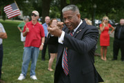 Former Rep. Allen West (R-FL) pretends to target a friend he spotted in the crowd before a news conference organized by Special Operations Speaks Out (SOS) Political Action Committee at the U.S. Capitol July 23, 2013 in Washington, DC. Members of SOS unrolled a 60-foot-long scroll bearing the names of more than 1,000 Special Service veterans demanding a full investigation of the September 11, 2012, Benghazi attacks.