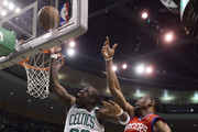 Mickael Pietrus #28 of the Boston Celtics heads for the basket as Thaddeus Young #21 of the Philadelphia 76ers defends in Game Two of the Eastern Conference Semifinals in the 2012 NBA Playoffs on May 14, 2012 at TD Garden in Boston, Massachusetts. NOTE TO USER: User expressly acknowledges and agrees that, by downloading and or using this photograph, User is consenting to the terms and conditions of the Getty Images License Agreement.