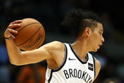 Jeremy Lin #7 of the Brooklyn Nets dribbles against the Philadelphia 76ers during their Pre Season game at Nassau Veterans Memorial Coliseum on October 11, 2017 in Uniondale, New York.   NOTE TO USER: User expressly acknowledges and agrees that, by downloading and/or using this Photograph, user is consenting to the terms and conditions of the Getty Images License Agreement.