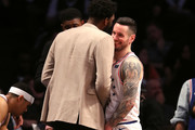 Joel Embiid #21 of the Philadelphia 76ers helps JJ Redick #17 to his feet in the fourth quarter against the Brooklyn Nets during game three of Round One of the 2019 NBA Playoffs at Barclays Center on April 18, 2019 in the Brooklyn borough of New York City. NOTE TO USER: User expressly acknowledges and agrees that, by downloading and or using this photograph, User is consenting to the terms and conditions of the Getty Images License Agreement.
