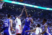 Joel Embiid #21 of the Philadelphia 76ers shoots the ball as Serge Ibaka #9 of the Toronto Raptors defends during Game One of the second round of the 2019 NBA Playoffs at Scotiabank Arena on April 27, 2019 in Toronto, Canada.  NOTE TO USER: User expressly acknowledges and agrees that, by downloading and or using this photograph, User is consenting to the terms and conditions of the Getty Images License Agreement.