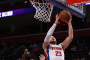 Blake Griffin #23 of the Detroit Pistons gets to the basket past Joel Embiid #21 of the Philadelphia 76ers during the second half at Little Caesars Arena on October 23, 2018 in Detroit, Michigan. Detroit won the game 133-132 in overtime. NOTE TO USER: User expressly acknowledges and agrees that, by downloading and or using this photograph, User is consenting to the terms and conditions of the Getty Images License Agreement.