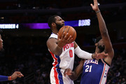 Andre Drummond #0 of the Detroit Pistons tries to get a shot off around Joel Embiid #21 of the Philadelphia 76ers during the second half at Little Caesars Arena on October 23, 2018 in Detroit, Michigan. Detroit won the game 133-132 in overtime. NOTE TO USER: User expressly acknowledges and agrees that, by downloading and or using this photograph, User is consenting to the terms and conditions of the Getty Images License Agreement.