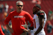 DeSean Jackson #11 of the Tampa Bay Buccaneers talks with head coach Dirk Koetter during a game against the Philadelphia Eagles at Raymond James Stadium on September 16, 2018 in Tampa, Florida.