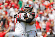 Ryan Fitzpatrick #14 of the Tampa Bay Buccaneers reacts with his teammates after throwing a touchdown against the Philadelphia Eagles during the first half at Raymond James Stadium on September 16, 2018 in Tampa, Florida.