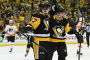 Sidney Crosby and Jake Guentzel Photos Photo